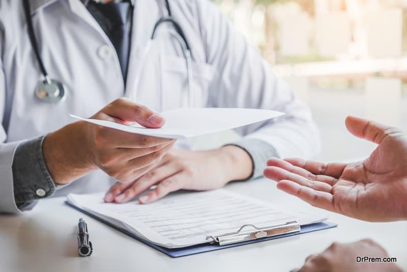 doctor giving health certificate