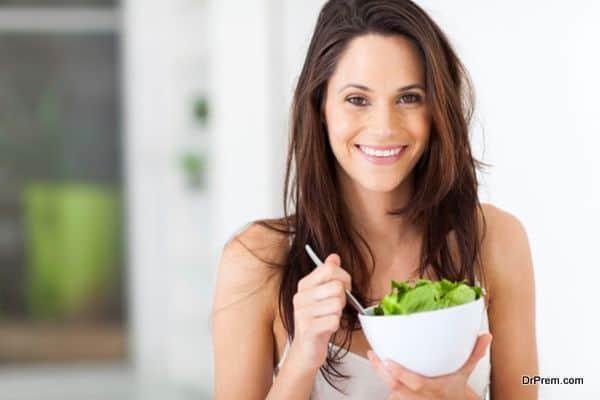 young woman eating healthy salad