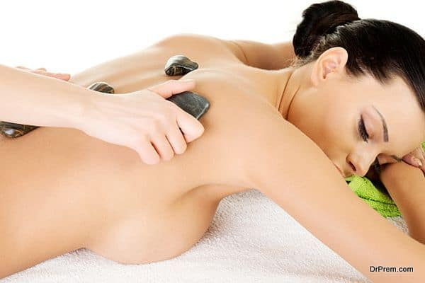 Attractive woman lying on bed. Spa concept.