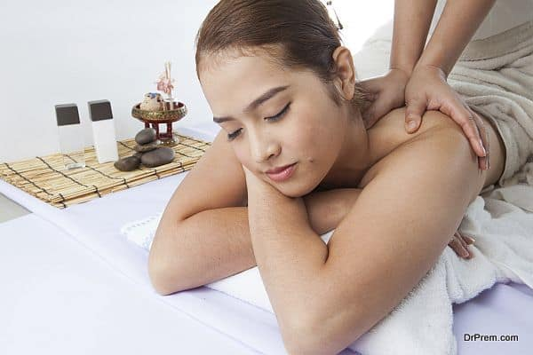 Close-up of a young woman receiving back massage at spa