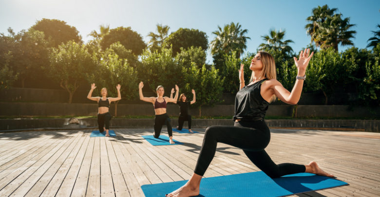 womens-are-doing-yoga-in-a- resort