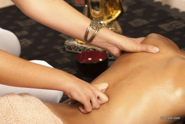 Therapist hands working on a female back