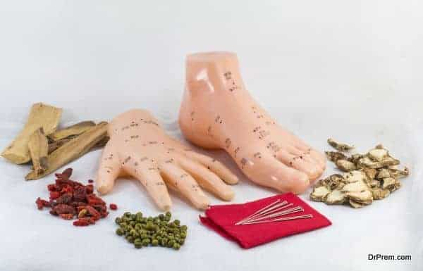 Chinese herbal medicine with acupuncture needles and hand foot m