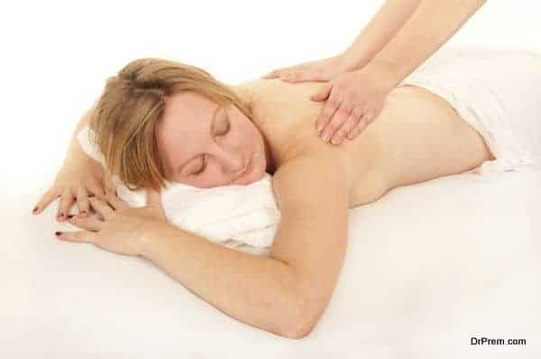 Natural young woman receiving a massage