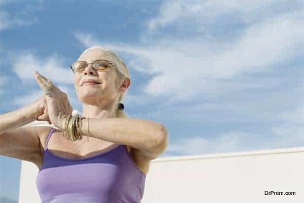 Senior woman in yoga or tai chi pose