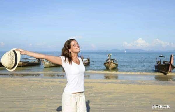 Woman enjoying freedom on Thailand travel at beach
