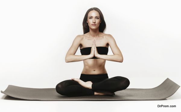 Young attractive woman doing yoga