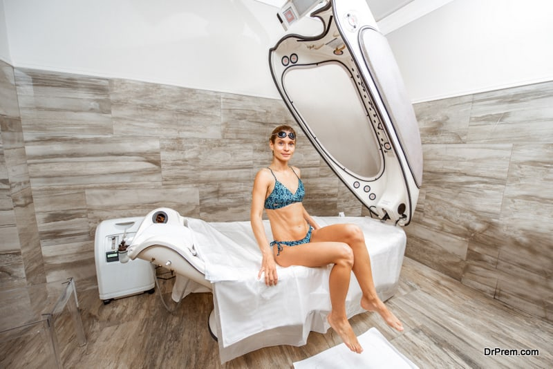 Woman on the spa capsule