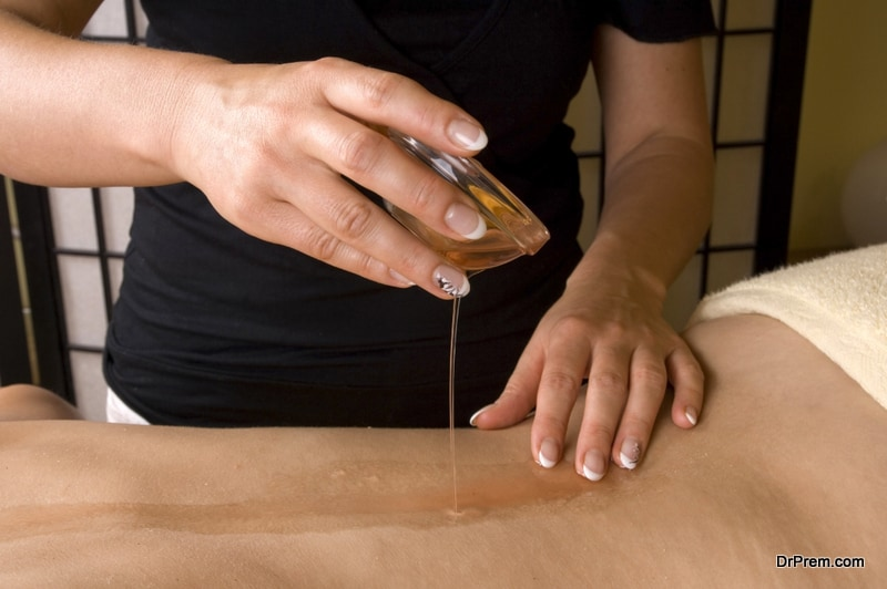 Massage oil is evenly applied over the skin