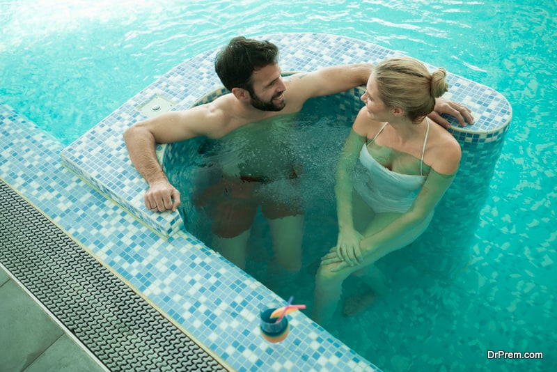 Couple enjoying bubble bath and hydrotherapy