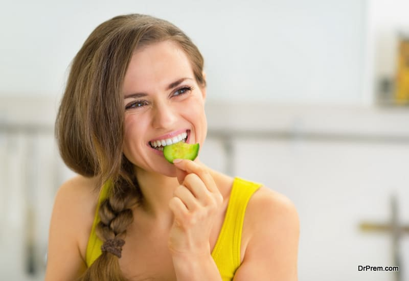 woman consuming water-based foods for hydration