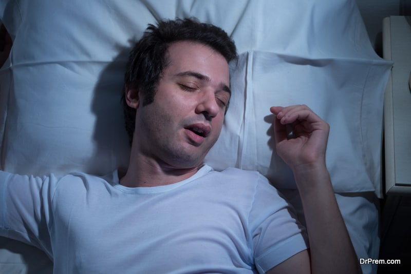 Man is sleeping in his bed