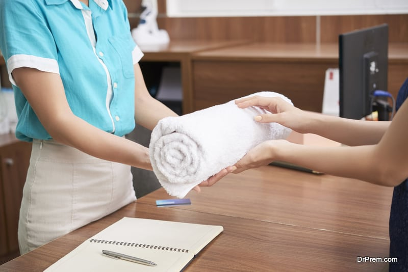 administrator offering towel to client