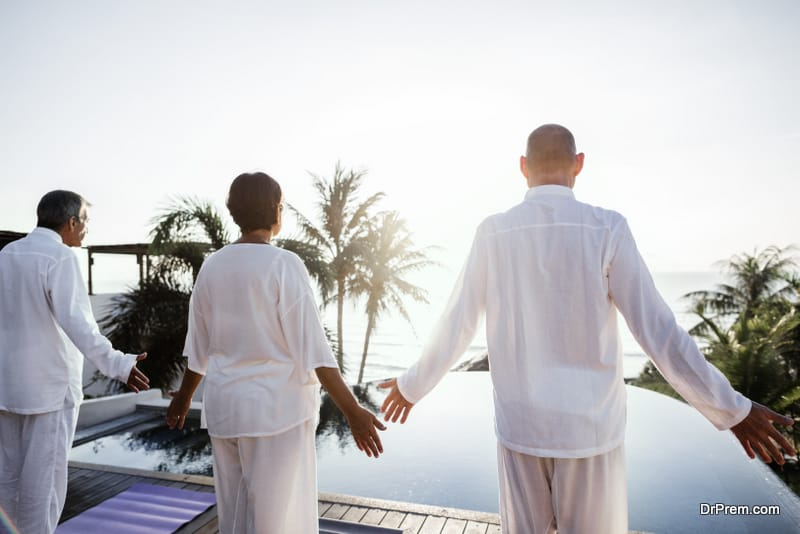 people practicing yoga in a Spiritual wellness retreat