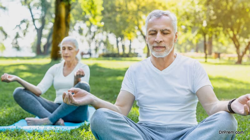 Senior couple sitting in lotus pose