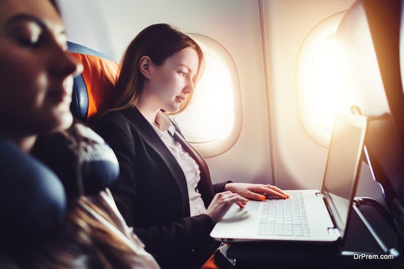 Female entrepreneur in airplane