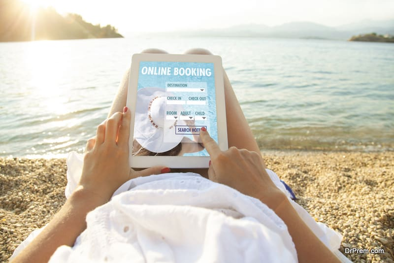 woman doing online booking of the resort