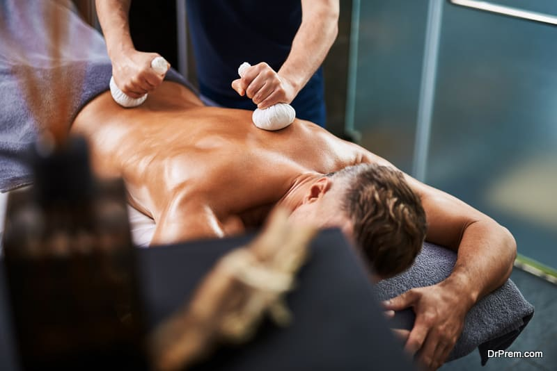 Young man receiving Ayurveda spa treatment at wellness center