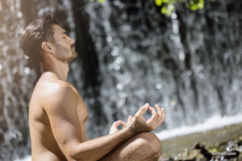 male engaged in mindful meditation