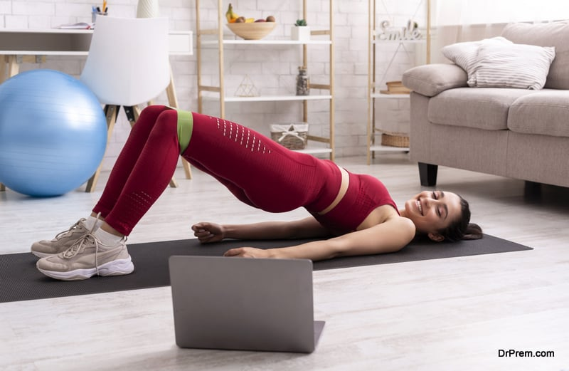 woman exercising in the confines of the home