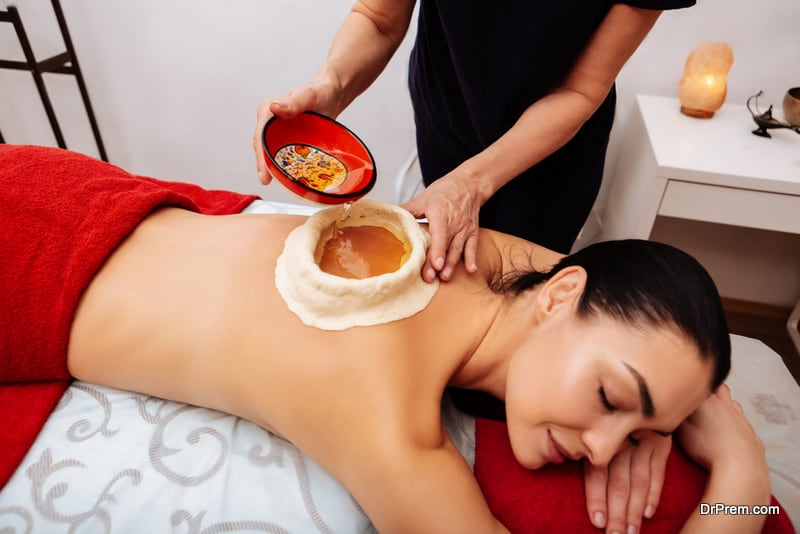 young woman receiving panchkarma therapy
