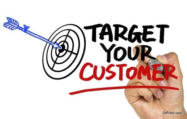 target your customer concept hand drawing on whiteboard