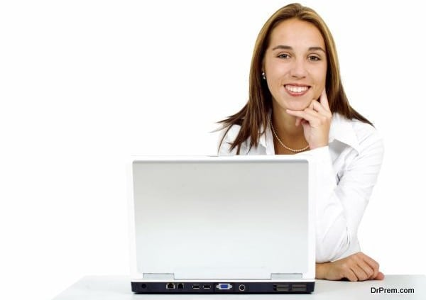 Business woman on a laptop computer in her desk isolated over a white background