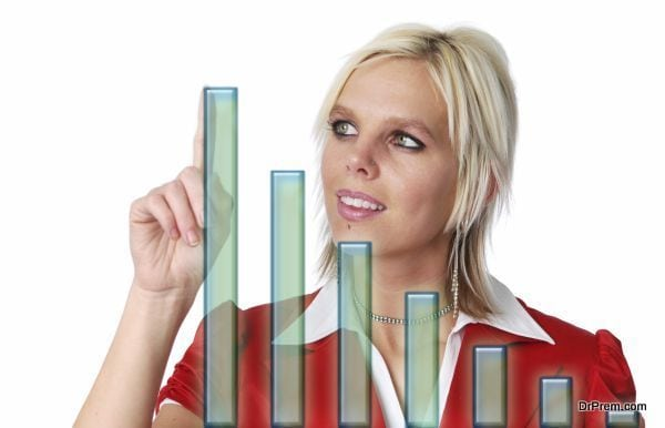 Beautiful businesswoman with bar chart isolated on white