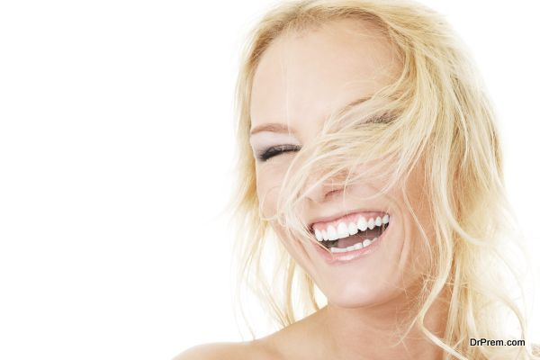 Attractive woman with fly-away hair isolated over white background
