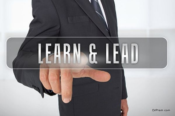 Serious businessman touching the term learn and lead