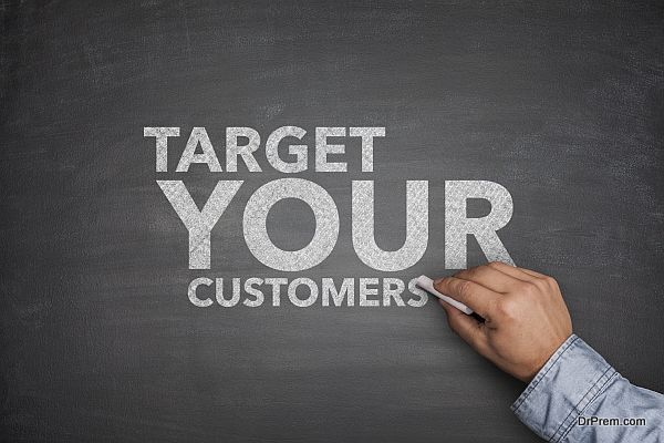 Target your customers on black Blackboard with hand