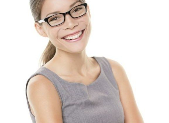 Woman wearing glasses eyewear. Portrait of young female professinal business woman wearing glasses looking at camera smiling happy. Multiracial woman model isolated on white background..