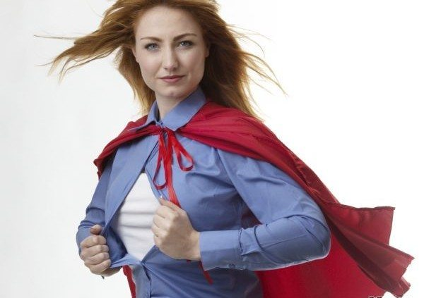 business woman wearing a super hero cape with wind in her hair