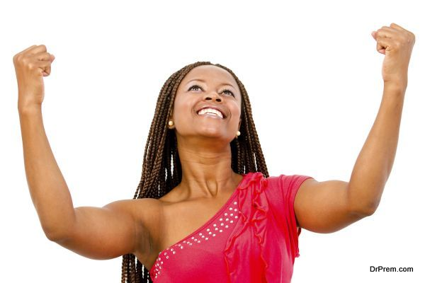 Black woman with arms up