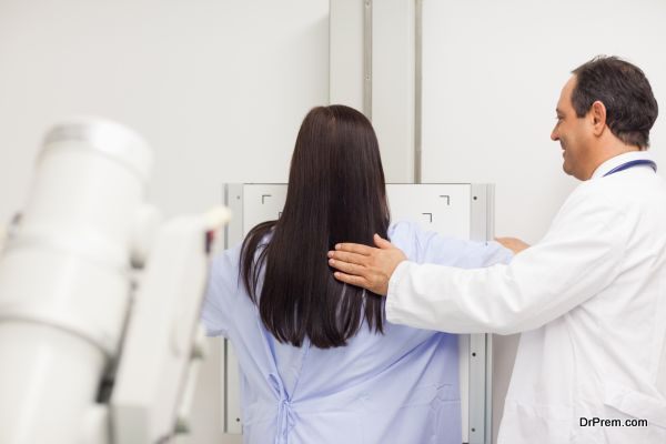 Doctor proceeding a mammography on a patient