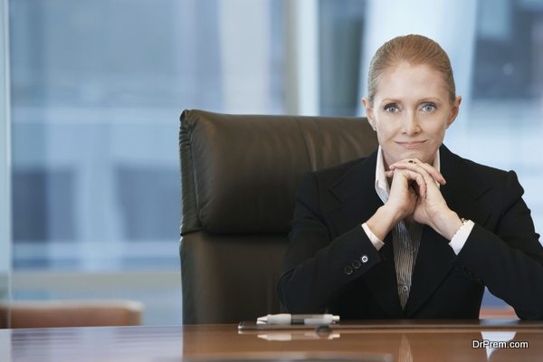 Confident Businesswoman At Conference Table