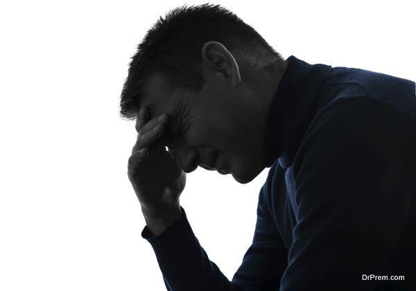 man headache pain silhouette portrait